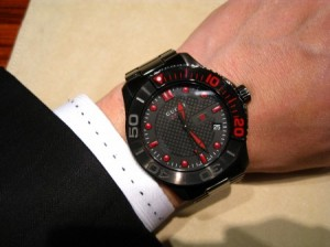 Image of the Gucci G-Timeless YA126230 watch on a man's wrist