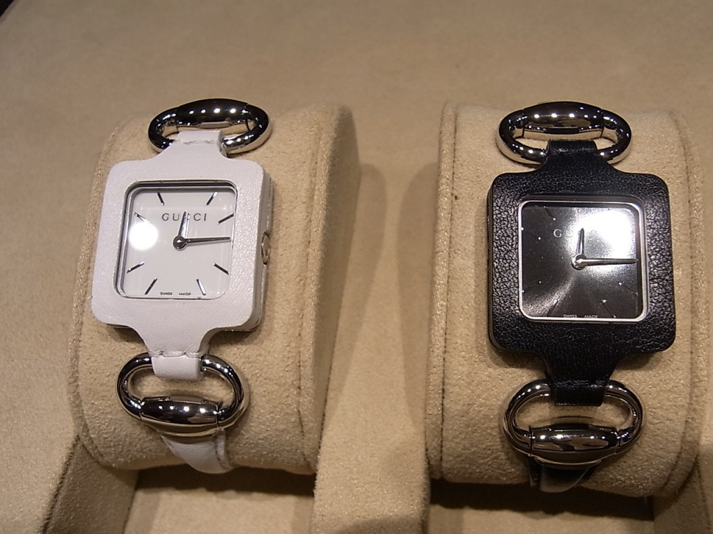 Gucci 1921 watches on display. Black and White versions