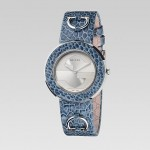 Gucci U-Play Slate Blue Ostrich Paw displayed on watch.