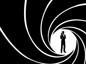 Silhouette of James Bond seen from the barrel of a gun.