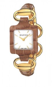 Brown leather gucci watch with gold links and accents